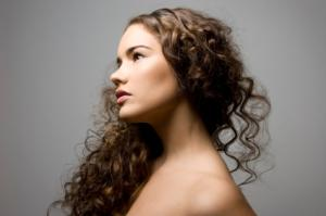Brunette woman with curly hair extensions