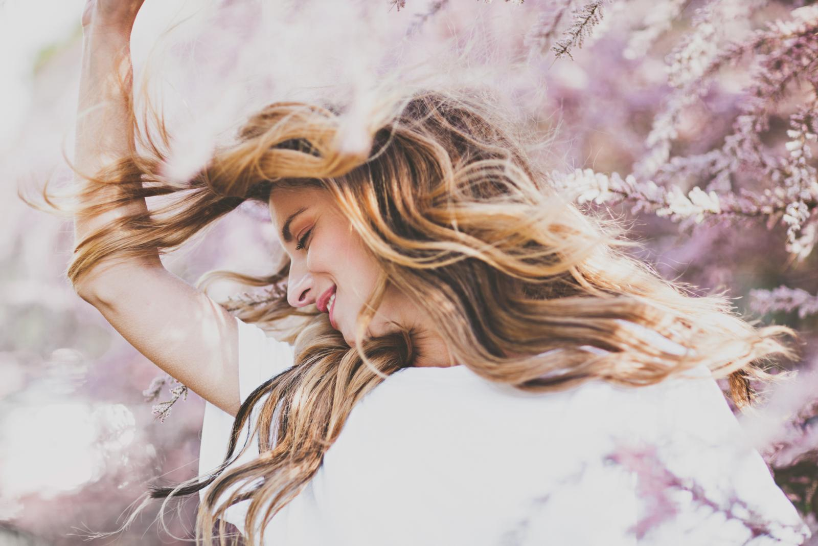 Girl with beautiful hair enjoying springtime