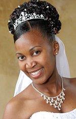 Bride wearing a tiara and pearl hair pins