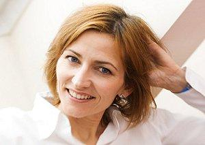 Woman with a short, layered haircut
