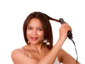 Lady flatironing her hair