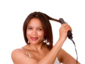 Lady flatironing her hair