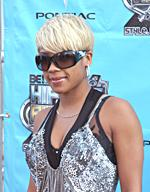 Keyshia Cole with a short blonde hairstyle