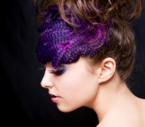 Woman wearing purple feathered hair accessory