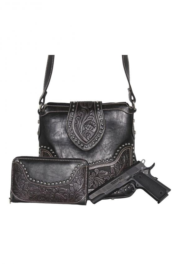 https://cf.ltkcdn.net/handbags/images/slide/202651-566x850-Concealed-Carry-Tooled-Messenger-Purse.jpg