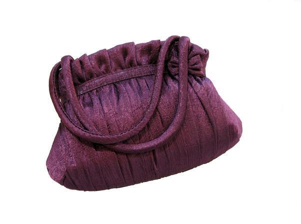 https://cf.ltkcdn.net/handbags/images/slide/38694-603x448-Eggplant-Bag.jpg