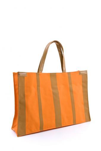 https://cf.ltkcdn.net/handbags/images/slide/138539-566x848r2-canvas-beach-bag-stripes.jpg