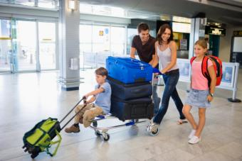 family with travel bags