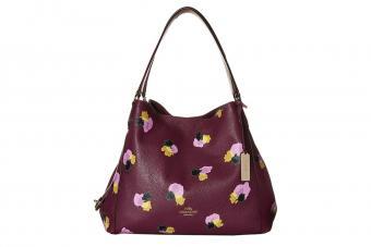 https://cf.ltkcdn.net/handbags/images/slide/210237-850x567-coach-edie-31-shoulder-bag-plum-field.jpg