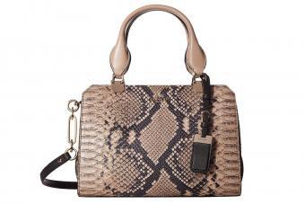 https://cf.ltkcdn.net/handbags/images/slide/210328-850x567-coach-madison-diamond-python-bag.jpg