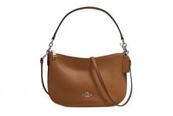 https://cf.ltkcdn.net/handbags/images/slide/210331-850x567-Coach-Chelsea-Pebble-Leather-Crossbody-Bag.jpg