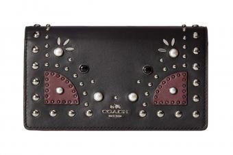 https://cf.ltkcdn.net/handbags/images/slide/211357-850x567--Coach-Western-Foldover-Crossbody-Clutch.jpg