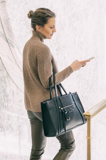 Woman with leather shoulder bag