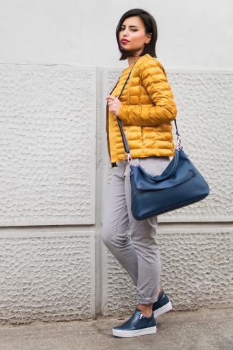 Woman holding blue messenger bag