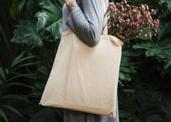 Woman with shopping tote over shoulder