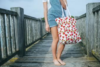 Girl with watermelon patterned beach tote