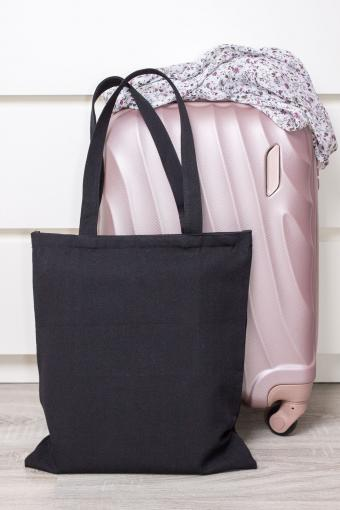 Black tote used as travel bag
