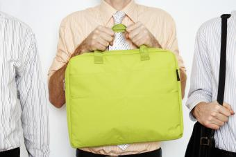 Man holding yellow tote computer bag