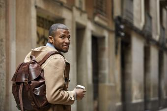 Man with a leather backpack