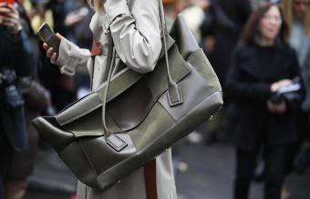 woman wearing a maxi Bottega Veneta bag