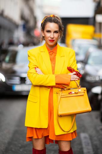 Alexandra Lapp is wearing a yellow Kelly bag from Hermes during Paris Fashion Week
