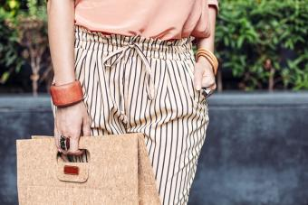 Stylish woman carrying purse outdoors