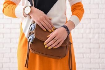 Stylish woman carrying a brown handbag