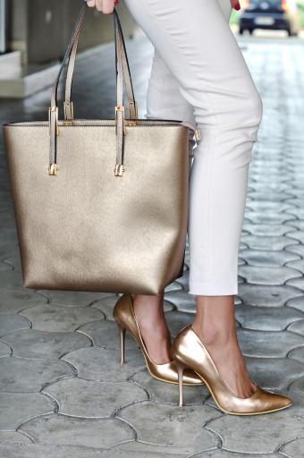 Fashionable woman with metallic handbag and coordinating shoes