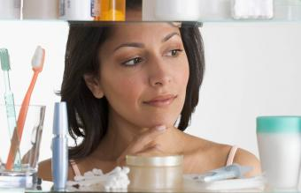 woman in front of a bathroom cabinet