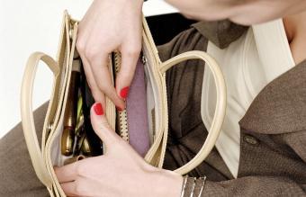 Woman searching through handbag