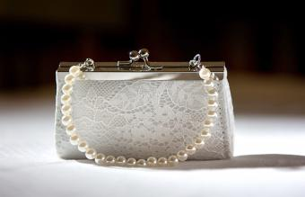 White clutch purse with pearls and lace