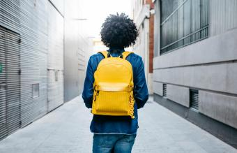 man with yellow backpack