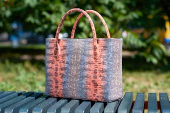 woman's bag with snake skin imitation
