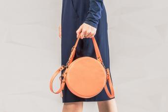 woman with orange round bag