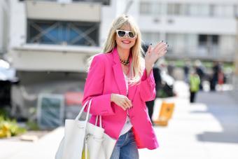Heidi Klum with white bag/ Getty Editorial Use