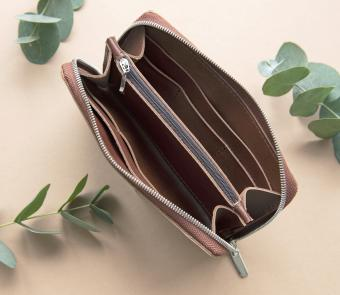 Opened brown leather purse