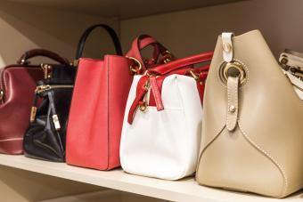 Handbags stored in woman's closet