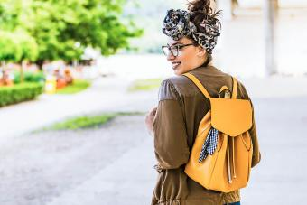 woman wearing backpack style purse