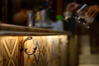 Purse hook on a bar