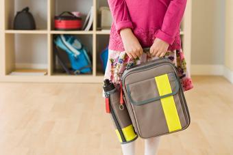 girl holding backpack