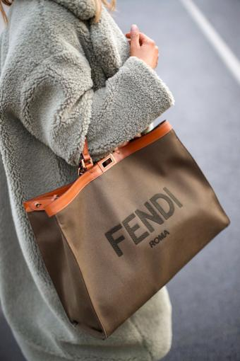 Woman carrying shopper by Fendi