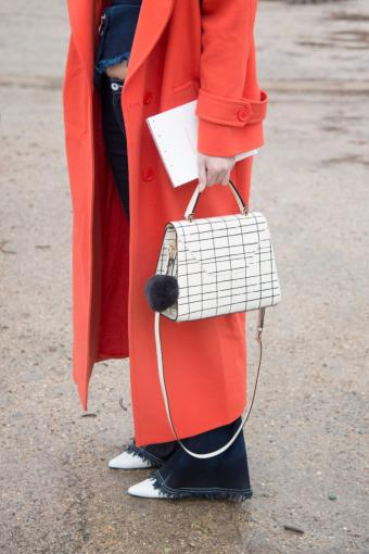 Stila Chan wears red jacket and a Valextra bag