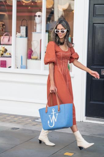 Isabella Charlotta Poppius carries a J.W Anderson bag
