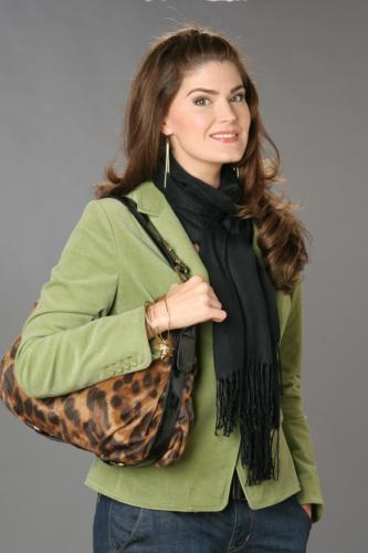 andy paige wearing a cheetah print handbag