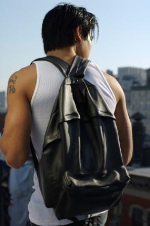 man wearing a black leather bookbag