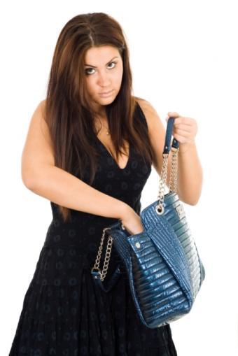 https://cf.ltkcdn.net/handbags/images/slide/38782-430x644-Wearhandbag6.jpg