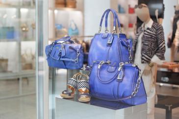 Coach handbags on display