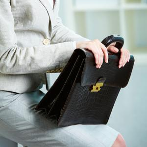 Businesswoman with a leather briefcase tote