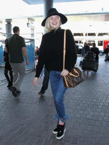 Elle Fanning with Louis Vuitton bag