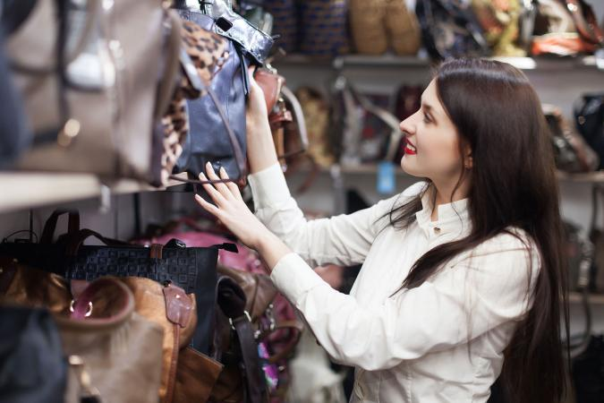 Woman shopping for handbag